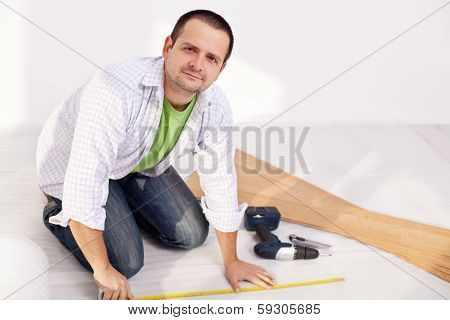 Man Preparing To Lay Some Laminate Floor Planks