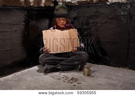 Begging Homeless Child Sitting With A Blank Sign And Some Change