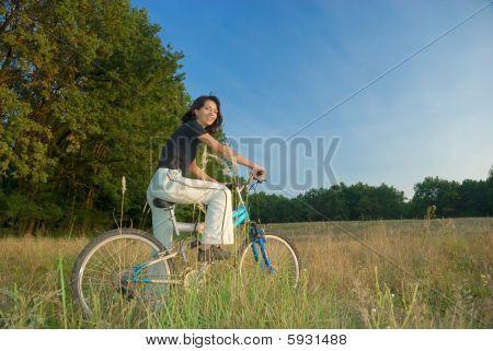 Girl Bike And Nature