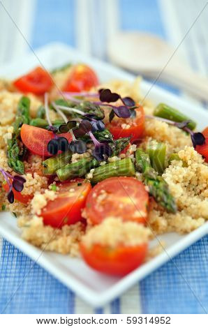 Healthy Couscous Salad with tomatoes and green asparagus