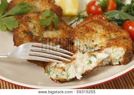 Easy to make fishcakes, with steamed fish crumbled into mashed potato and parsley mix, thickened with some flour, rolled in breadcrumbs and fried, served with a salad.