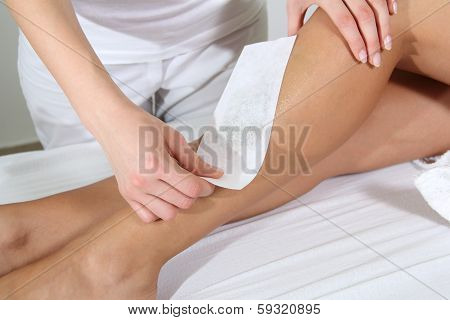 Woman Legs Waxed In Spa