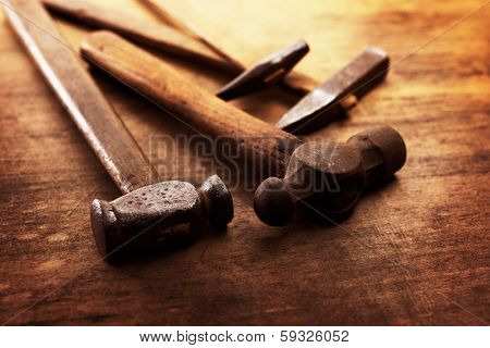 Old Hammers on a old wooden workdesk