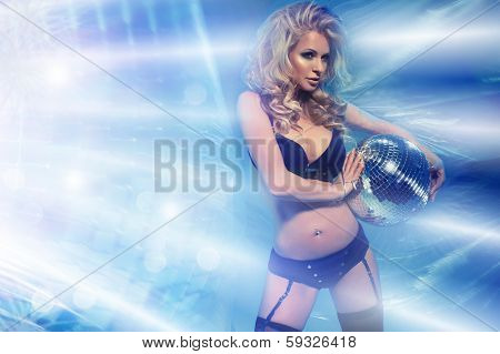 Young Sexy Woman In Blue Lingerie Keeping Disco Ball