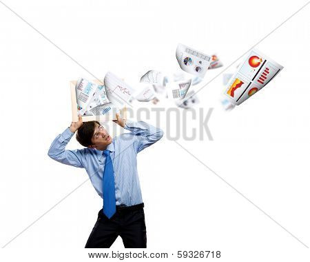 Young businessman holding frame above head with papers flying out