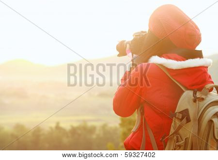 Nature Photographer Taking Pictures During Hiking Trip