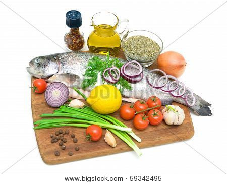 Trout And Different Food On A Cutting Board On A White Background.