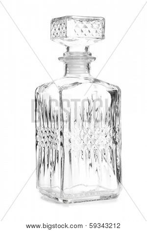 Glass decanter of whiskey on white background