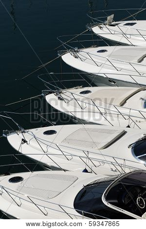 Bows Of A Row Of Luxury Motorboats