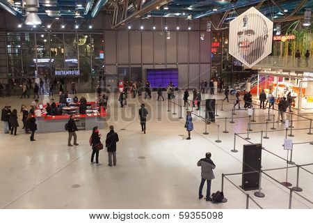 PARIS, FRANCE - JANUARY 4, 2012: Tourists in a lobby of The Pompidou Centre, one of the world's most popular cultural venues and one of the most visited monuments in France.