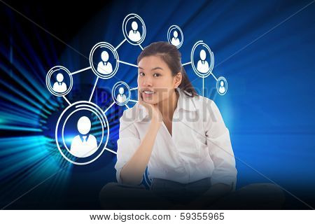 Businesswoman sitting cross legged thinking against digital earth background