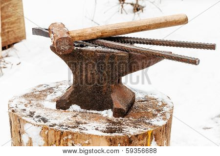 Anvil With Blacksmith Tongs Hammer In Smithy
