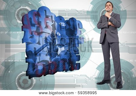 Thoughtful businessman holding pen to chin against technology wheel background