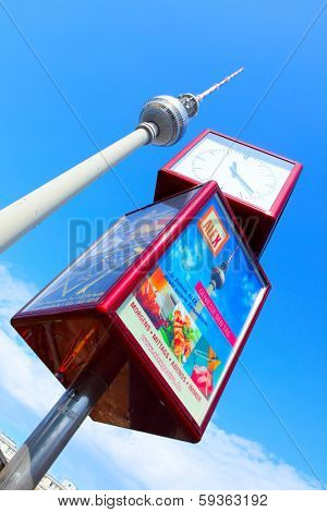 BERLIN, GERMANY - AUGUST 22, 2012: Fernsehturm (Television Tower) and street clock near Alexanderplatz in Berlin