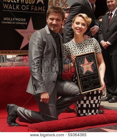 LOS ANGELES - MAY 01:  Jeremy Renner & Scarlett Johansson arrives to the Walk of Fame Ceremony for Scarlett Johansson  on May 01, 2012 in Hollywood, CA