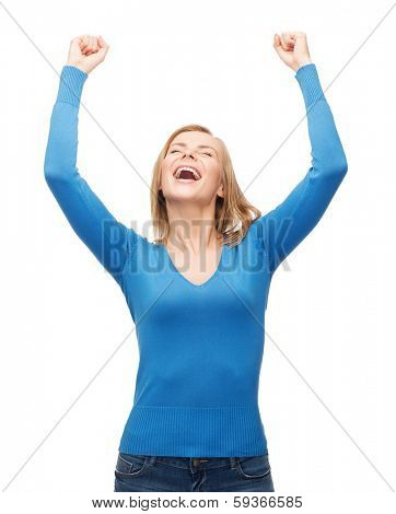 happiness and people concept - laughing young woman with hands up and closed eyes