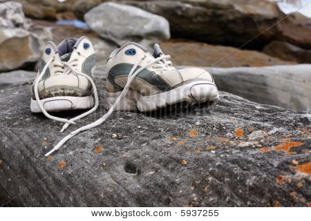 Old Worn Sports Shoes Outside
