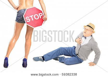 Senior gentleman looking at sexy woman with stop sign, and experiencing heart attack isolated on white background