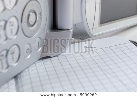 cellphone and notepad