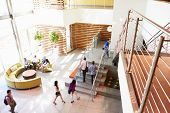 picture of reception-area  - Reception Area Of Modern Office Building With People - JPG