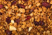 stock photo of hazelnut  - Healthy homemade granola or muesli with oats dried raisin almonds hazelnuts and honey - JPG