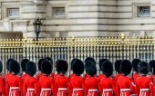 LONDON, UK - MAY 08, 2013: Royal guards at Buckingham Palace during the State Opening of Parliament.