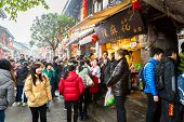 CHONGQING, CHINA - JAN 17: Unidentified tourists are shopping at Ciqikou Ancient Town on January  17