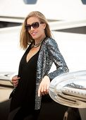 picture of diva  - Young diva leaning on private jet wing - JPG