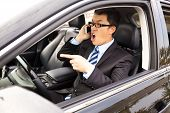 Irate Businessman Talking With Cell Phone