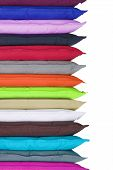 pic of puffy  - Stack of bright pillows on white background - JPG