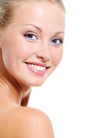 stock photo of blonde woman  - Woman face with a nice smile and healthy beautiful clear skin over white backgrouns - JPG