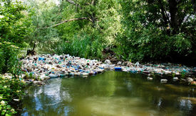 pic of non-biodegradable  - A dam of plastic bottles poluting a river - JPG