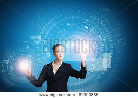 Young attractive businesswoman touching icon of digital screen