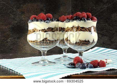 Healthy Diet High Dietary Fiber Breakfast With Bran Cereal, Yoghurt And Berries Trifles On Black Sla
