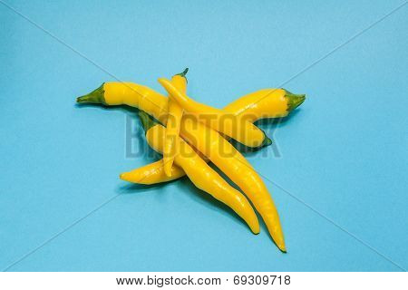 Yellow Hot Chili Pepper Isolated On Blue