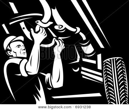 car mechanic working underneath a car