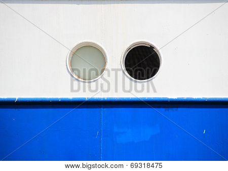 Two Portholes On Blue And White Coaster Background