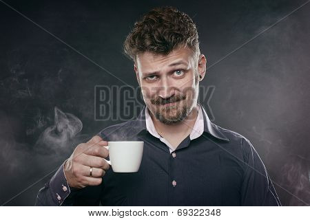 handsome beard man stands in fog with cup of coffee