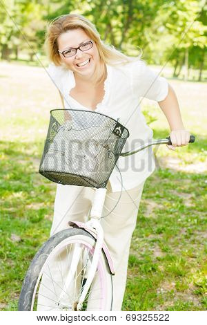 Cheerful Young Woman On The Bike