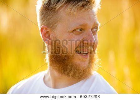 Cheerful Blond Bearded Man In ?-shirt