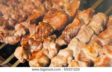 Prepared shashlik, lamb meat grilling on metal skewer