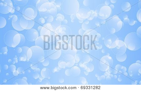 Scattered Bokeh Effect On A Light Blue Background
