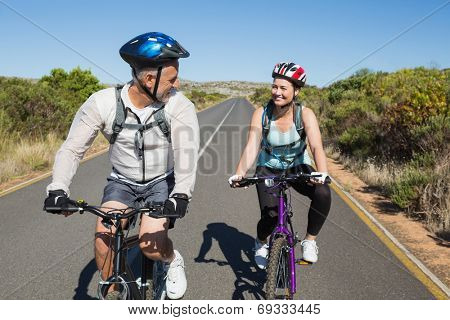 Active couple going for a bike ride in the countryside on a sunny day
