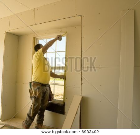Man Measuring Window