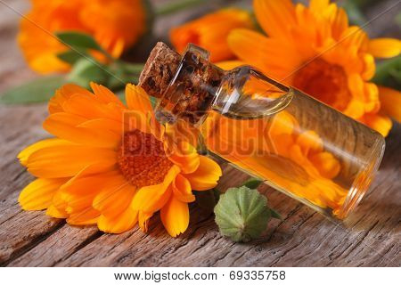 Calendula Oil In A Glass Bottle On An Old Table Horizontal