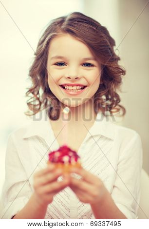 picture of beautiful pre-teen girl with cupcake