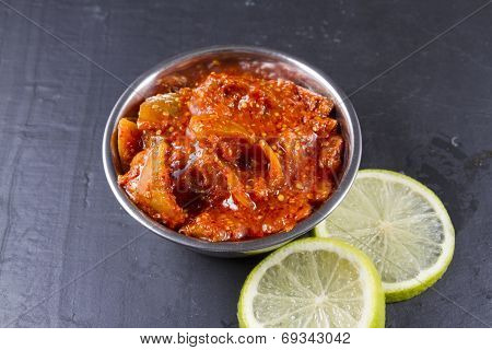 Lime Pickle With Lime Slices On Slate Background