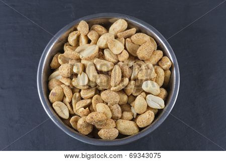 Dry Roasted Peanuts In Metal Bowl  On Slate.