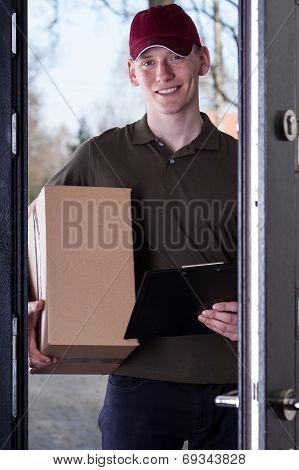 Courier With Order Standing In Door