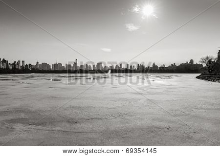 Frozen Jacqueline Kennedy Onassis Reservoir and NYC famous skyline, B&W